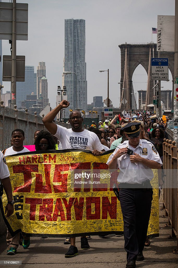 Protestors in support of Trayvon Martin march across the Brooklyn Bridge after attending a rally organized by the Reverend Al Sharpton in response to the non-guilty verdict for George Zimmerman on July 20, 2013 in New York City. In February 2012, Zimmerman shot and killed Trayvon Martin, a teenager, in Sanford, FL; he was found not guilty of murder due to Stand-Your-Ground laws. Protests have continued across the country since Zimmerman was found not guilty on July 13, 2013.
