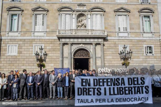 Protestors including Carles Puigdemont Catalonia's president and other regional government officials take part in a silent demonstration outside the...