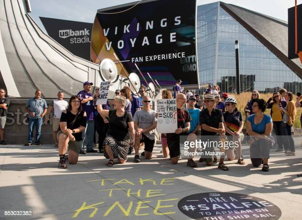 Protestors kneel outside US Bank Stadium before the Minnesota Vikings game in Minneapolis Minnesota The protest in support of Colin Kaepernick comes...