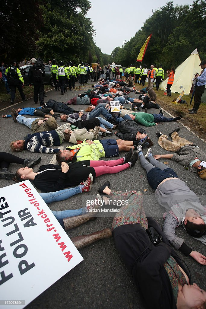 Protestors lay on the road in protest outside the gates to the Cuadrilla site on July 31 2013 in Crawley West Sussex Protesters continue to gather...