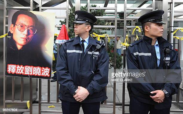 Protestors leave banners and yellow ribbons outside the China liaison office to protest over Chinese dissident Lu Xiaobo in Hong Kong on December 25...