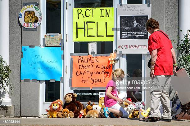 Protestors leave more signs and stuffed animals in front of the dental practice River Bluff Dental of Dr Walter Palmer on July 29 in Bloomington Minn...