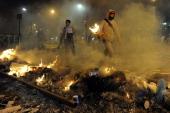 Protestors light fires during an antigovernment demo in Caracas on February 19 2014 Venezuelan President Nicolas Maduro successor of the late Hugo...