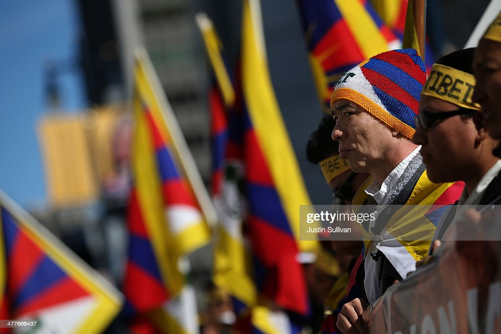 Protestors look on during a demonstration outside of San Francisco City Hall on March 10, 2014 in San Francisco, California. Hundreds of activists marked the 55th anniversary of the 1959 Tibetan uprising and the fifth anniversary of Tibetan self-immolation protests in Tibet.