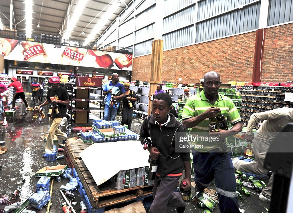 Protestors loot a liquor store on January 21, 2013, in Sasolburg, South Africa. Protesting broke out as a result of the announcement of the intention to integrate municipal systems from Sasol to Pary.