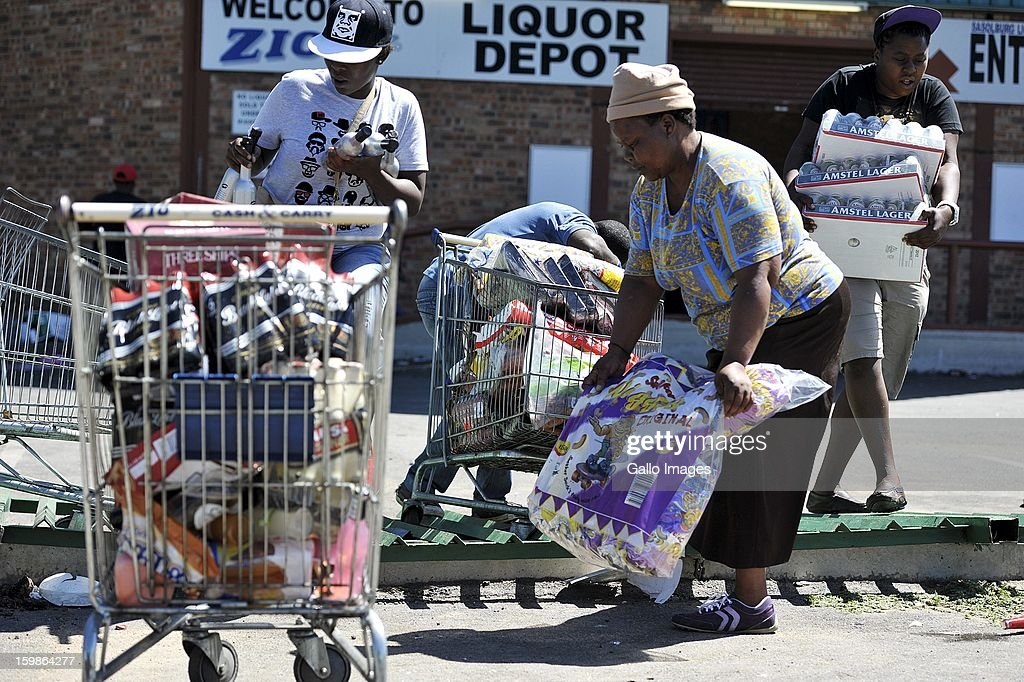 Protestors loot local shops on January 21, 2013, in Sasolburg, South Africa. Protesting broke out as a result of the announcement of the intention to integrate municipal systems from Sasol to Parys.