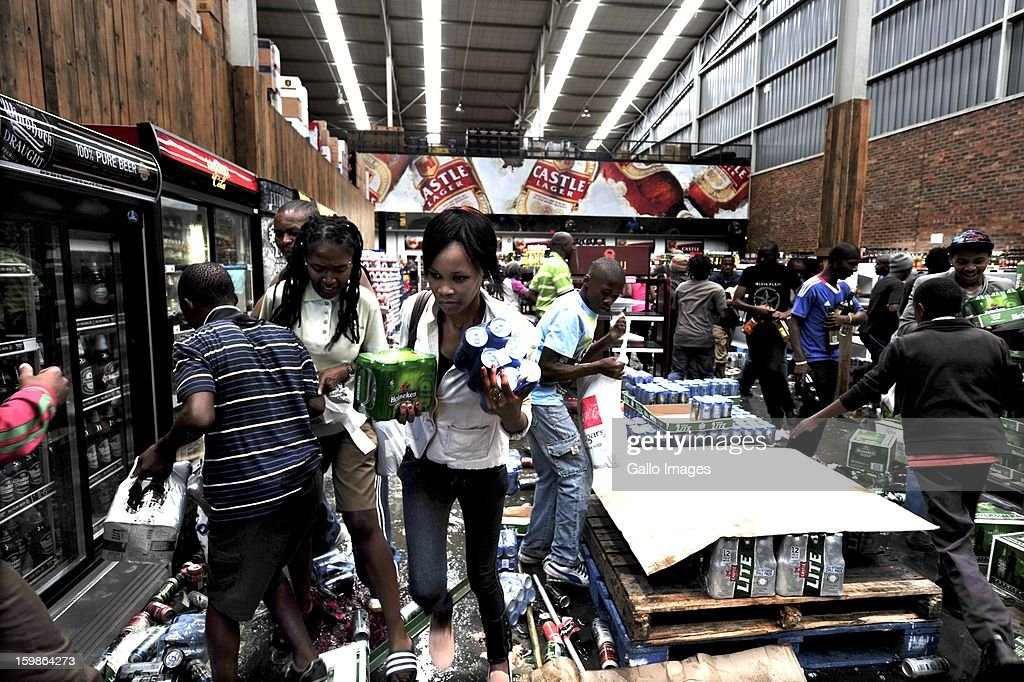 Protestors looting a liquor store on January 21, 2013, in Sasolburg, South Africa. Protesting broke out as a result of the announcement of the intention to integrate municipal systems from Sasol to Parys.