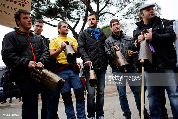 Protestors make noise with cowbells during a protest in favour of a generational change at the countryside in Madrid Spain wednesday 15th Jan 2014...