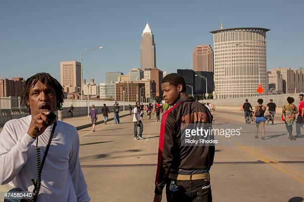 Protestors march across the Detroit Superior Bridge as people take to the streets and protest in reaction to Cleveland police officer Michael Brelo...