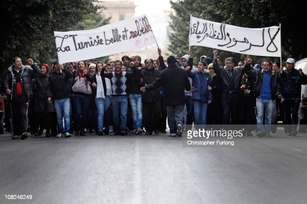 Protestors march along Tunis's Avenue Habib Bourguiba on January 22 2011 in Tunis Tunisia Policemen joined the people of Tunis to protest about their...