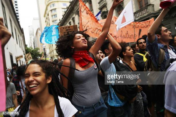 Protestors march at demonstrations during a nationwide general strike on April 28 2017 in Rio de Janeiro Brazil The general strike was conducted in...