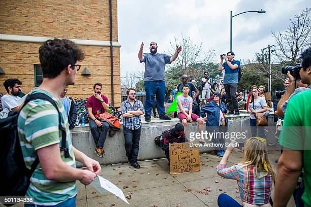Protestors march at the site of a mock mass shooting close to The University of Texas campus December 12 2015 in Austin Texas In addition to the...
