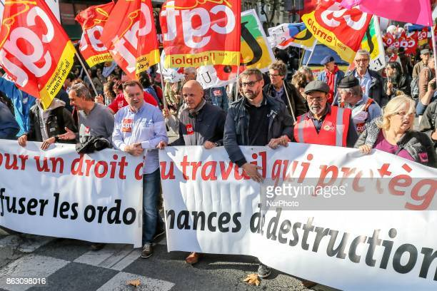 Protestors march carrying a banner during a demonstration called by the General Confederation of Labour French worker's union in Paris on October 19...