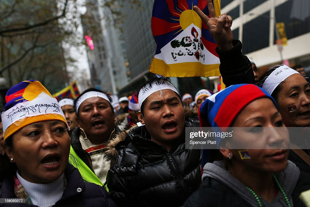 Protestors march down 42nd street to the United Nations General Assembly Building in recognition of International Human Rights Day on December 10, 2012 in New York City. Chinese-occupied Tibet has witnessed over 90 Tibetans self-immolating themselves in protest to China since 2009. Tibetans, their supporters and human rights activists are calling for immediate action by the United Nations and world governments to pressure China to resolve the issue.