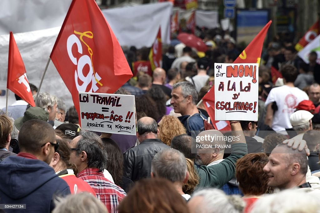 Protestors march during a demonstration against proposed government labour and employment law reforms on May 26, 2016 in Toulouse. Workers at nuclear power stations in France were set to go on strike May 26, joining a growing protest movement against controversial labour market reforms that has already severely disrupted fuel supplies. Unions have called for fresh rallies in cities across France on May 26, the latest bout of social unrest that started around three months ago and has frequently turned violent. PAVANI