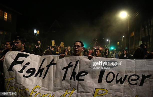 Protestors march during a demonstration on December 8 2014 in Berkeley California Protestors have taken to the streets of Berkeley for a third...