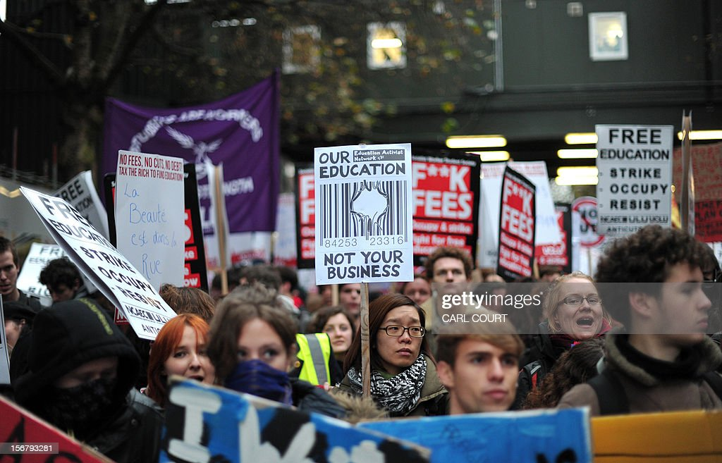 Protestors march during a student rally in central London on November 21, 2012 against sharp rises in university tuition fees, funding cuts and high youth unemployment. AFP PHOTO/CARL COURT