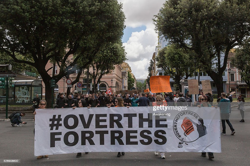 Protestors march during May Day protests on May 01, 2016 in Rome, Italy. Police clashed with protestors as hundreds took to the streets to participate in May Day marches and gatherings across Italy, with many demonstrators protest against Erdogan decisions about the migrant crisis.