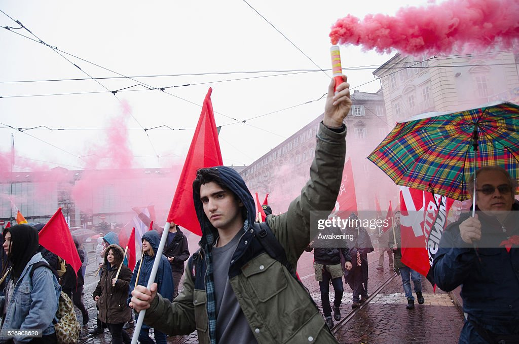 Protestors march during May Day protests on May 01, 2016 in Turin, Italy. Police clashed with protestors as hundreds took to the streets to participate in May Day marches and gatherings across Italy, with many demonstrators demanding a solution to the migrant crisis.