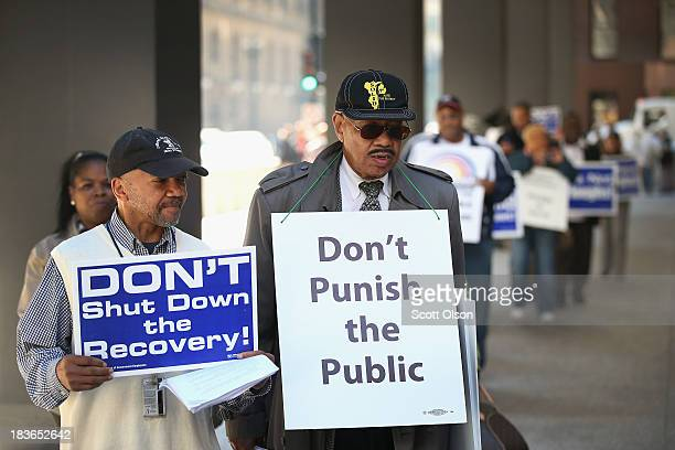 Protestors march in the Federal Building Plaza to call for an end to the federal government shutdown on October 8 2013 in Chicago Illinois The...