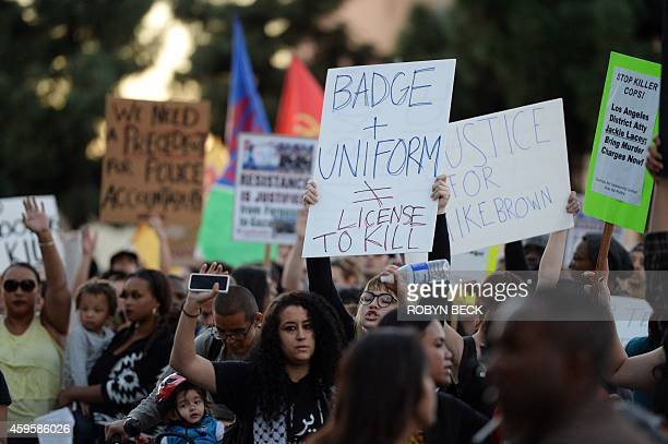 Protestors march November 25 2014 in Los Angeles one day after a grand jury decision not to prosecute a white police officer for the killing of an...