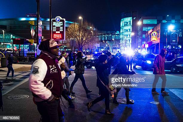 Protestors march past police cruisers on Prospect Ave December 21 in Cleveland Ohio Demonstrators from Ferguson Missouri travelled to Cleveland...