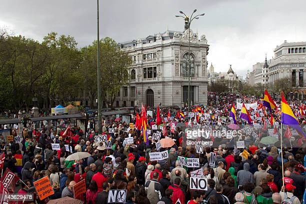 Protestors march past the headquarters of Spain's central bank left during a labor demonstration on May Day in Madrid Spain on Tuesday May 1 2012...