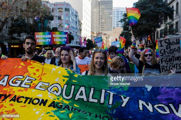 Protestors march through the Sydney CBD for Gay marriage on August 6 2017 in Sydney Australia The federal government is under increasing pressure to...