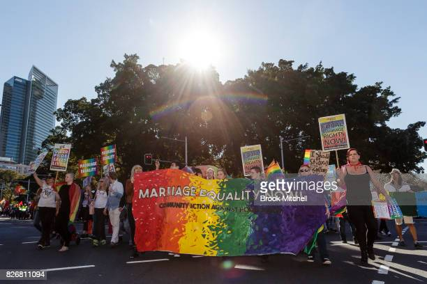 Protestors march through the Sydney CBD for Gay Rights on August 6 2017 in Sydney Australia The federal government is under increasing pressure to...