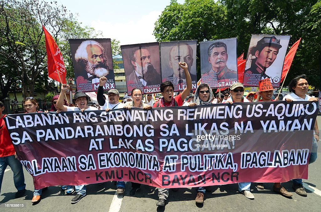 Protestors march towards the United States Embassy on May 1, 2013 in Manila, Philippines. Philippine workers unions gather in the streets of Manila to demand, among other things, better pay, an end to contractualization and layoff and the lowering of prices of basic commodities. Labor day is celebrated across South East Asia on May 1st and is seen as an opportunity to acknowledge the social and economic accomplishments of the workers.