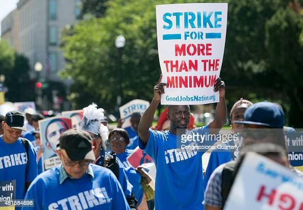 Protestors marches towards Upper Senate Park during a rally on Capitol Hill in Washington Wednesday July 22 to push for a raise to the minimum wage...