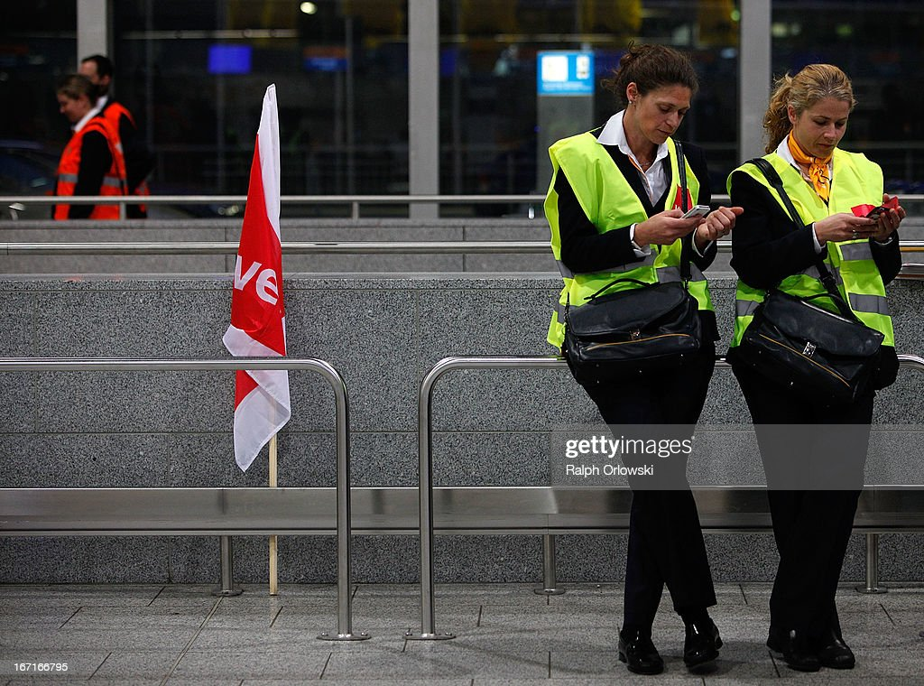 Protestors of Lufthansa ground, service and maintenance personnel check their mobile phones during a nationwide protest at Frankfurt Airport on April 22, 2013 in Frankfurt, Germany. Workers are demaning pay raises and job guarantees and today's strike has forced Lufthansa to cancel approximately 1700 flights.