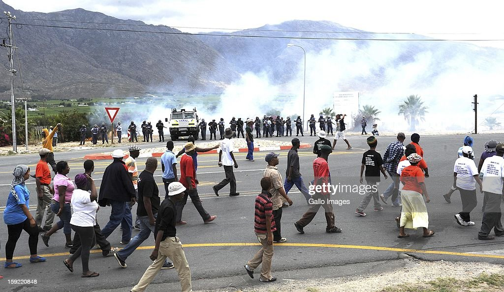 Protestors on the N1 De Doorns protest on January 9, 2013, in Cape Town, South Africa. The farm workers shut down the N1 by lighting tires on fire and placing large rocks on the road in their attempt to negotiate R150 a day wages.