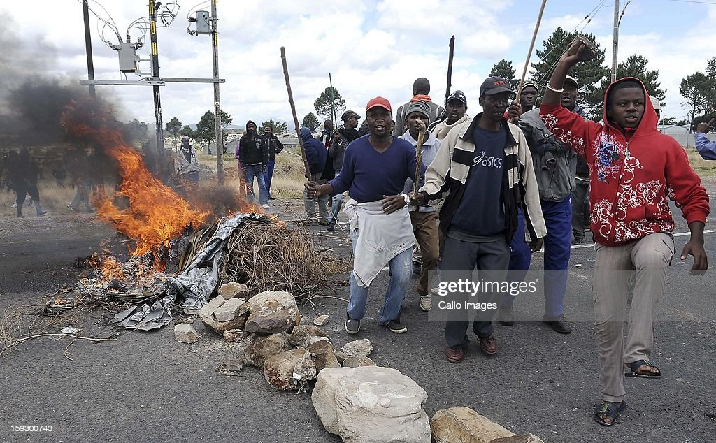 Protestors on the N2 highway on January 10, 2013 in Grabouw, South Aifrca. Striking farm workers have blocked the highway as they continue striking.