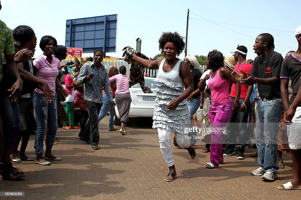 Protestors outside the Daveyton Police station on February 28, 2013 in Daveyton, South Africa. A Mozambican taxi driver, Mido Macia was handcuffed to the back of a police van and dragged for about 500m to the police station, where he later died. The officers involved have been suspended.