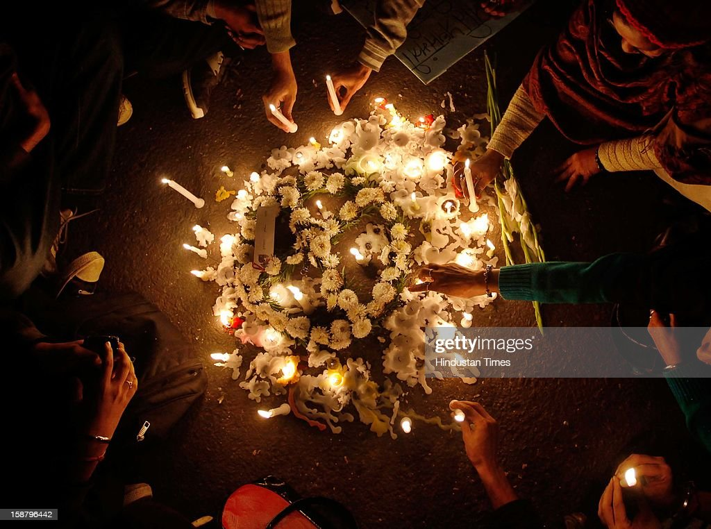 Protestors participate in a candle light vigil during a protest against a recent rape in a moving private bus, on December 29, 2012 in New Delhi, India.