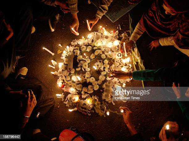 Protestors participate in a candle light vigil during a protest against a recent rape in a moving private bus on December 29 2012 in New Delhi India
