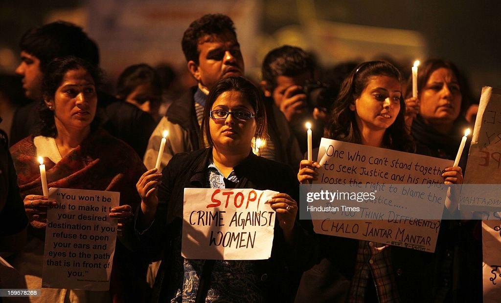 Protestors participate in a candlelight vigil to mark the passing of a month since a gang rape of a 23-year-old student in a bus, on January 16, 2013 in New Delhi, India. The incident enraged people who come out in large numbers to protests all over the country to demand safety and justice for women.