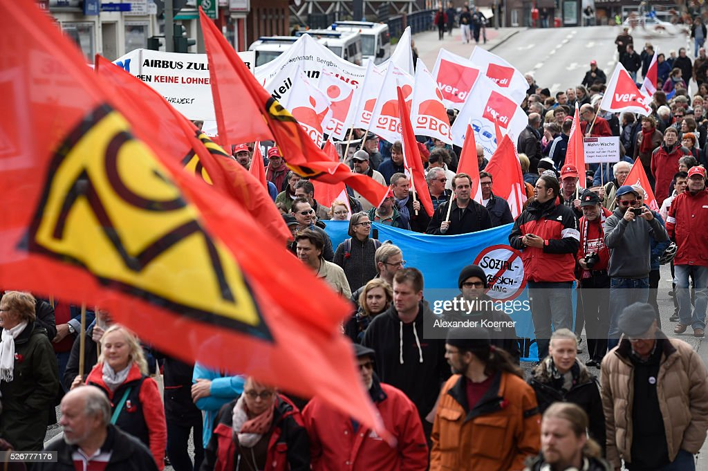 Protestors participate in the German Confederation of Trade Unions (DGB - Deutscher Gewerkschaftsbund) march on May Day on May 1, 2016 in Hamburg, Germany. Tens of thousands of people across Germany are expected to participate in marches and gatherings by labor unions.