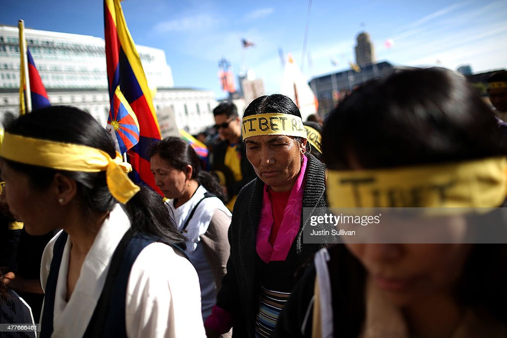 Protestors pause for a moment of silence during a demonstration outside of San Francisco City Hall on March 10, 2014 in San Francisco, California. Hundreds of activists marked the 55th anniversary of the 1959 Tibetan uprising and the fifth anniversary of Tibetan self-immolation protests in Tibet.
