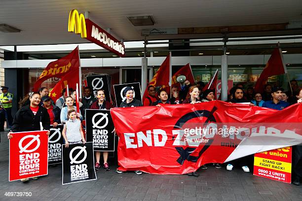 Protestors picket outside McDonalds in Britomart on April 15 2015 in Auckland New Zealand McDonald's workers will join thousands of fastfood workers...