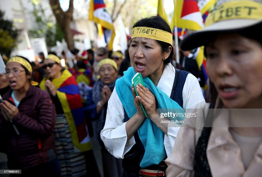 Protestors pray during a demonstration outside of the Chinese consulate on March 10, 2014 in San Francisco, California. Hundreds of activists marked the 55th anniversary of the 1959 Tibetan uprising and the fifth anniversary of Tibetan self-immolation protests in Tibet.