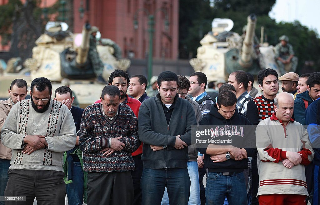 Protestors pray in sight of army tanks in Tahrir Square on January 31, 2011 in Cairo, Egypt. As President Mubarak struggles to regain control after six days of protests he has appointed Omar Suleiman as vice-president. The present death toll stands at 100 and up to 2,000 people are thought to have been injured during the clashes which started last Tuesday. Egyptians were forming vigilante groups in order to protect their homes after Police were nowhere to be seen on the streets.