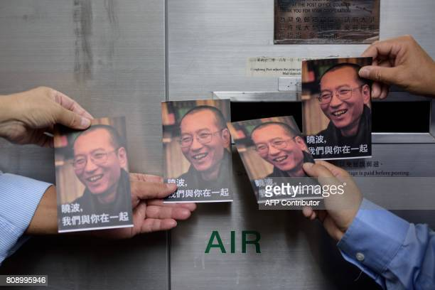 TOPSHOT Protestors prepare to post postcards written and addressed to terminallyill Chinese Nobel laureate Liu Xiaobo outside the General Post Office...