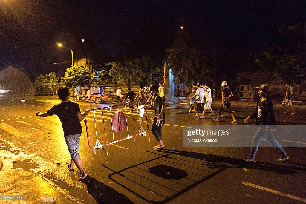 Protestors put fences on the road after clashes erupted near Monivong bridge South of Phnom Penh on September 15, 2013 in Phnom Penh, Cambodia. The CNRP plan a three day demonstration to contest the Cambodian national election results.