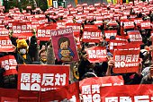 Protestors raise anti nuclear placards at a rally denouncing nuclear power plants in Tokyo on March 8 2015 Thousands of people took part in the...