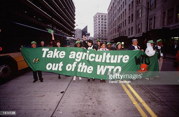 Protestors rally against the WTO in Seattle Washington November 29 1999 After a three hour delay today November 30 DirectorGeneral Mike Moore...