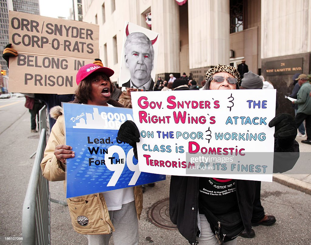 Protestors rally in front of the U.S. Courthouse in Detroit where Detroit's bankruptcy eligibility trial is taking place October 28, 2013 in Detroit, Michigan. Michigan Gov. Rick Snyder is expected to testify today at the trial. A federal judge will decide if the City of Detroit is eligible to be in bankruptcy court.