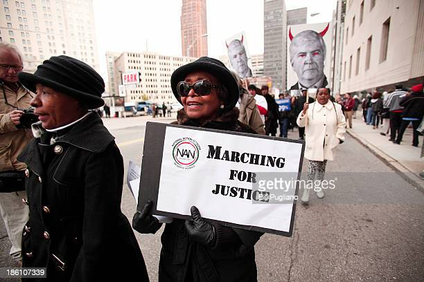 DETROIT MI Protestors rally in front of the US Courthouse in Detroit where Detroit's bankruptcy eligibility trial is taking place October 28 2013 in...