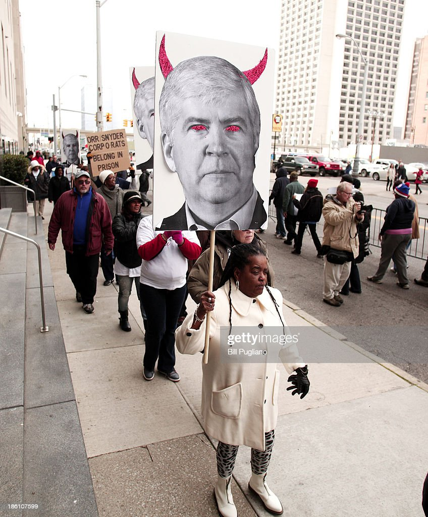 DETROIT, MI - Protestors rally in front of the U.S. Courthouse in Detroit where Detroit's bankruptcy eligibility trial is taking place October 28, 2013 in Detroit, Michigan. Michigan's Governor Rick Snyder is expected to testify today at the trial A federal judge will decide if the City of Detroit is even eligible to be in bankruptcy court.